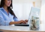 Caucasian businesswoman with tip jar